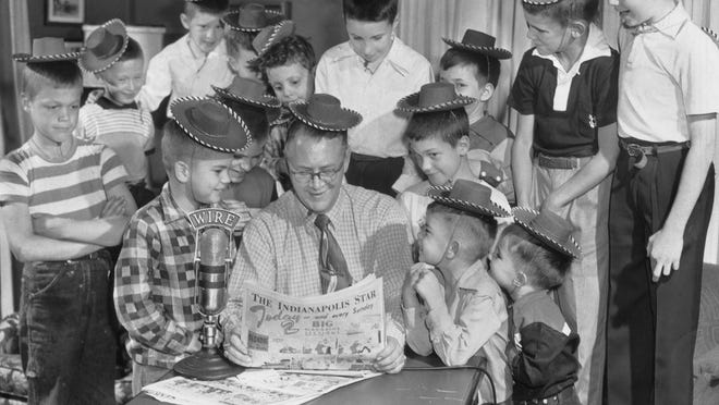"""WIRE radio personality """"Uncle Wally"""" Nerhling was the center of attention at a birthday party for Rick Eddy (left, front) and his brother Jimmy (right, front) in the youngsters' home April 29, 1953. Uncle Wally read The Indianapolis Star Sunday comics."""
