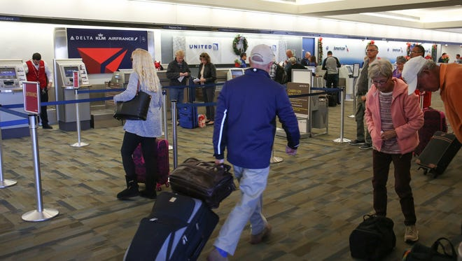 Passengers at Palm Springs International Airport fill public areas like ticketing and baggage claim in this December 2016 file photo. The airport is considering increasing its police security for the public, non-secure side of the airport.