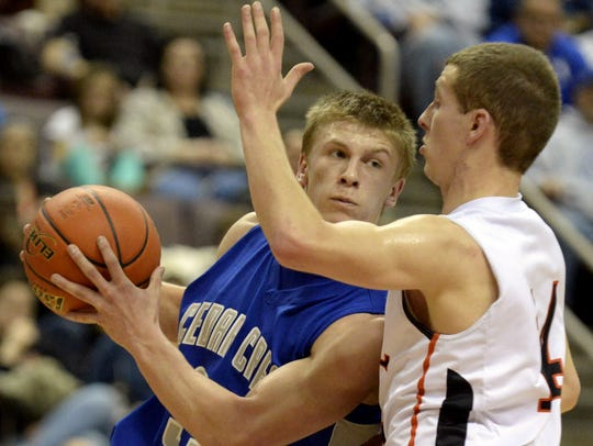 Cedar Crest's Evan Horn drives to the hoop against