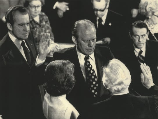 Gerald R. Ford (center) is sworn in as the 40th vice