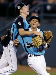 Goodlettsville All-Stars' Jake Rucker, left, celebrates