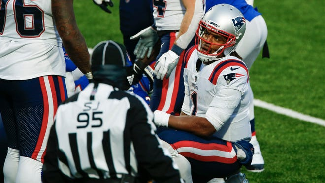 New England Patriots quarterback Cam Newton (1) reacts after fumbling the ball during the final drive of second half of an NFL football game against the Buffalo Bills Sunday, Nov. 1, 2020, in Orchard Park, N.Y. The ball was recovered by Dean Marlowe as the Bills won 24-21.