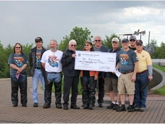"""As pictured, the Marathon Lions presented a check for $750 to The Highground during their June 4th """"Motorcycle Fun Run."""" The funds will be used to purchase educational materials for veterans and their families to help them cope with the effects of PTSD."""