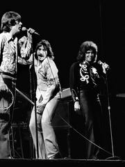 Three Dog Night members Cory Wells, left, Chuck Negron, center, and Danny Hutton in 1973.