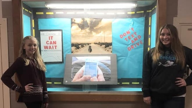 "Brianna Waller (left) and Paige Starr, members of Delsea Regional High School's DECA, share their showcase for the "" Message From Behind the Wheel"" public relations campaign."
