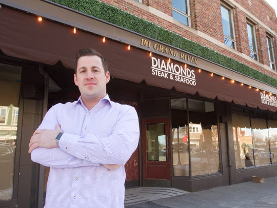 Diamonds Steak and Seafood owner Adam Merkel stands