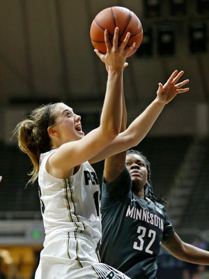 Bridget Perry gets past Karley Barnes of Minnesota for a shot Thursday, January 14, 2016, at Mackey Arena. Purdue defeated Minnesota 84-72.