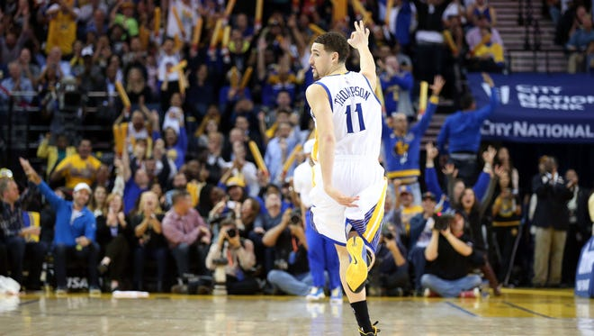 Klay Thompson gestures after a 3-pointer during the fourth period at Oracle Arena.