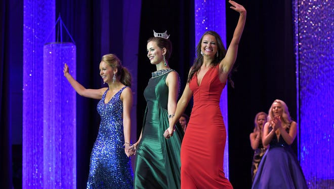 Miss St. Francis Gina Miliacca, left, winner of the talent competition,  and Miss Madison-Capital City Sarah Newton, right, winner of the lifestyle competition, join Miss Wisconsin 2015 Rosalie Smith as they wave to the crowd at the end of the Wednesday night competition. The Miss Wisconsin Scholarship Pageant got underway Wednesday evening with introductions of all the contestants. Preliminary talent and lifestyle and fitness were judged.