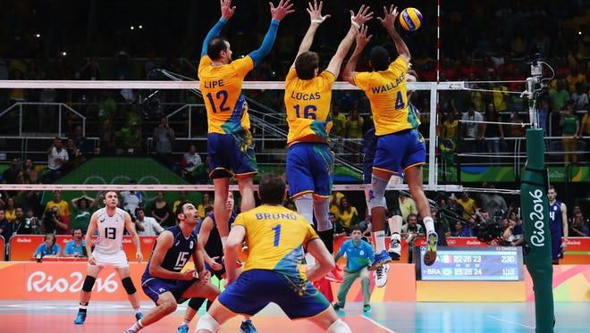 Fromt left, Luiz Felipe Marques Fonteles, Lucas Saatkamp and Wallace de Souza helped Brazil win its second men's volleyball gold medal.