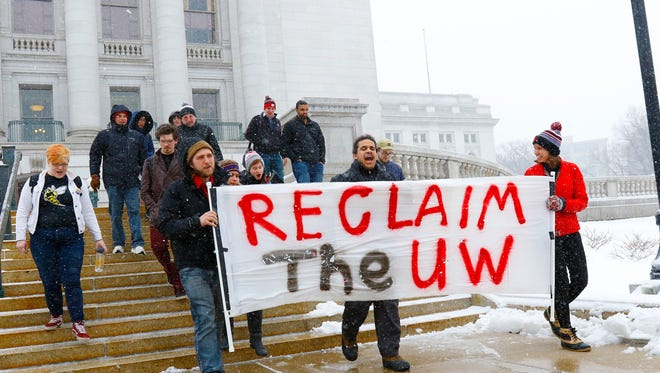 University of Wisconsin-Stevens Point students march their way to UW System Board of Regents offices Wednesday, April 18, 2018, in Madison, Wisc. T'xer Zhon Kha/USA TODAY NETWORK-Wisconsin