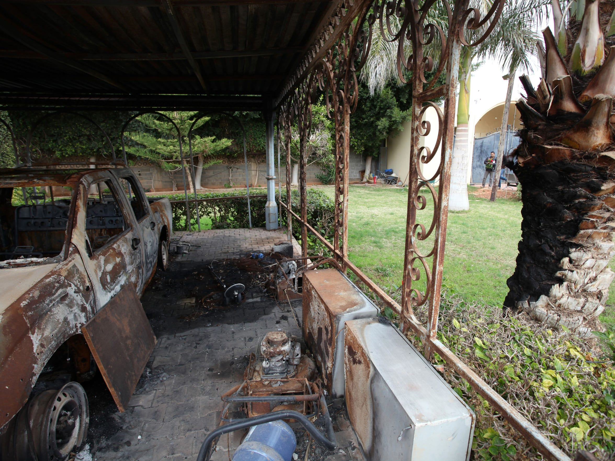 A charred vehicle sits at the U.S. Consulate in Benghazi,