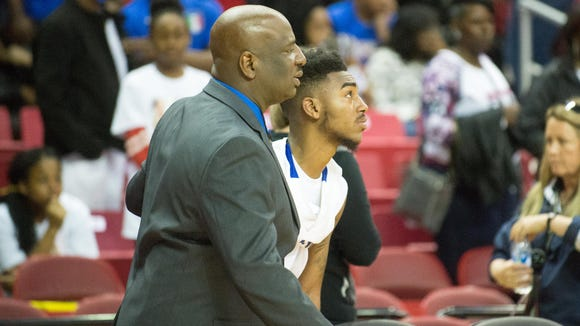 Stephen Decatur point guard Torrey Brittingham (3) and head coach Byron Johnson embrace after falling to C.M. Wright in the MPSSAA 3A State Championship on Saturday, March 12, at the Xfinity Center in College Park.