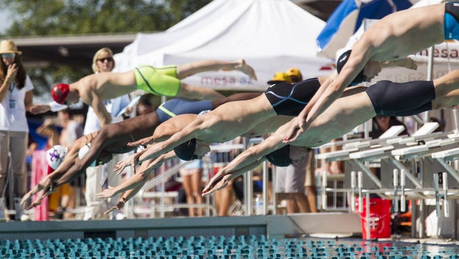 Racers dive into the pool to begin the boys' 100-yard breaststroke final during the Division II state swimming and diving championships at the Skyline Aquatic Center in Mesa on Saturday, Nov. 5, 2016.
