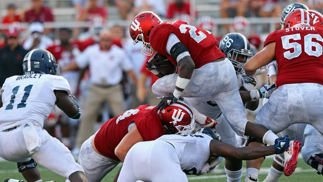 Indiana Hoosiers running back Morgan Ellison (27) leaps over defenders as he carries the ball against the Georgia Southern Eagles in the second half at Memorial Stadium.