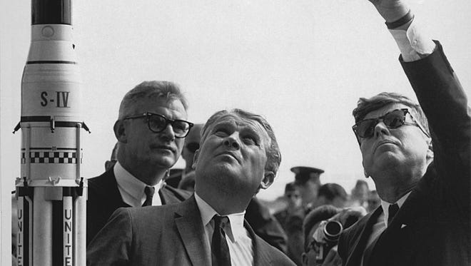Dr. Wernher von Braun, center, explains the Saturn Launch System to President John F. Kennedy, in Cape Canaveral, Fla. on Nov. 16, 1963.