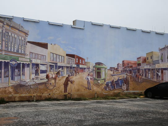 An old-time scene is painted on a building at Chadbourne
