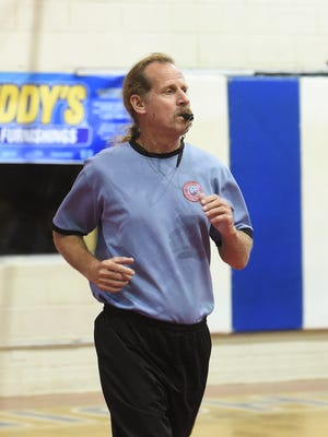 Marianas Sports Officials Association referee John Halloran calls a basketball game at St. John's School in Tumon on Jan. 10. Frank San Nicolas/Pacific Daily News/fsannicola@guampdn.com