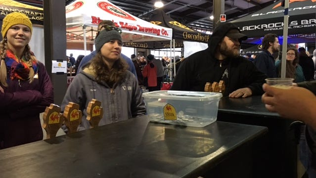 Brewery Vivant's abbess of beer Kate Avery talks to festival-goers Friday night at the Michigan Brewers' Guild Detroit Fall Beer Festival.