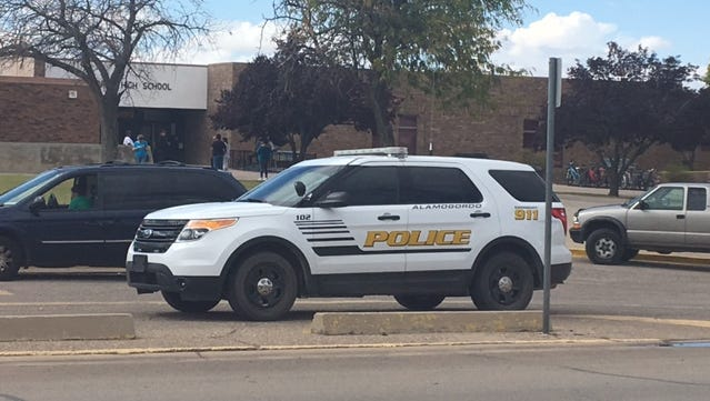 Alamogordo Police Department officers continue their investigation of a second man walking in the football field with a holstered firearm Tuesday, Oct. 10, 2017