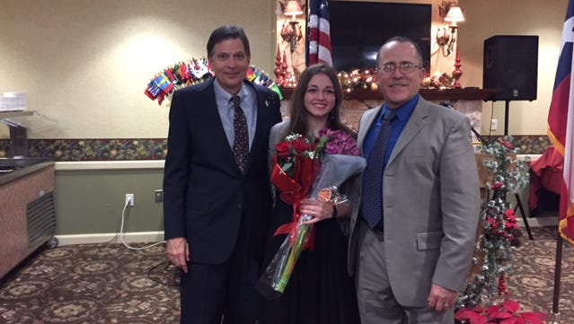 Danielle Elizabeth (center), pictured with Abilene Founders Lions Club president Jeff Eckard (left) and her father David Batiz (right), was named Lion Sweetheart for 2018 at the Abilene Founders Lions Club's annual banquet on Dec. 7.