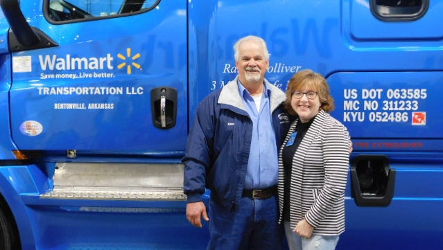 Randy Colliver and his wife Tammy with the tractor he received from Walmart for driving 3 million miles accident-free.