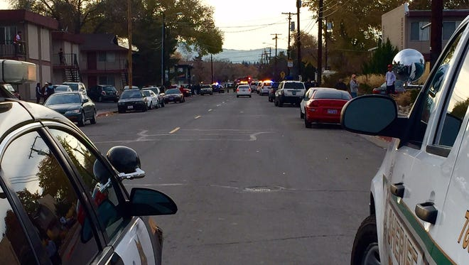 Reno Police and Washoe County Sheriff's officers block East Grove Street near Kietzke Lane on Sunday.