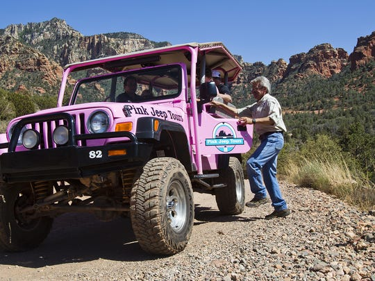 Paul Scherberger, right, gives a Pink Jeep tour to