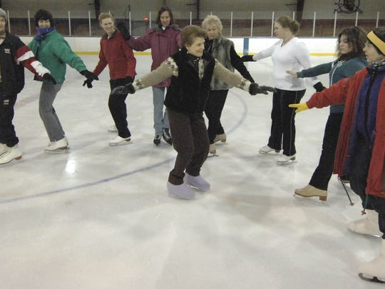 The Skating With Charlotte Ice Skating Class at the Marathon County Multi Purpose Building at Marathon Park, run by instructor Charlotte Hoecker, center.
