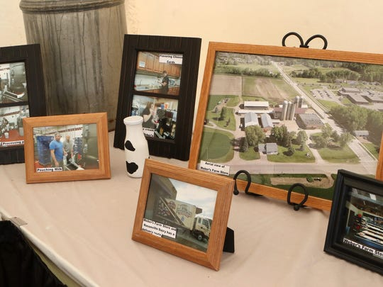 A display at the 2017 Farm Technology Days showed pictures of the families hosting the 2018 event. Pictured are images of Weber's Farm Store.