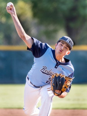 Redwood's Cam Gallardo pitches against Lemoore in a West Yosemite League high school baseball game on Thursday, April 12, 2018.
