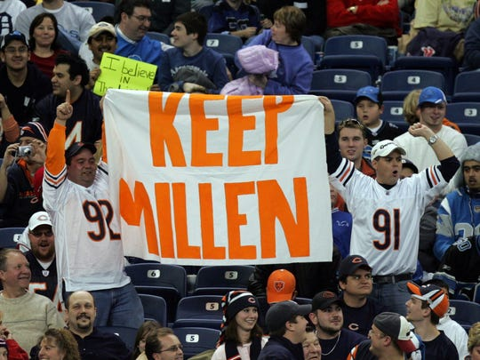 Chicago Bears fans hold up a banner mocking Lions fans' disdain for the team's president and CEO Matt Millen in 2006.