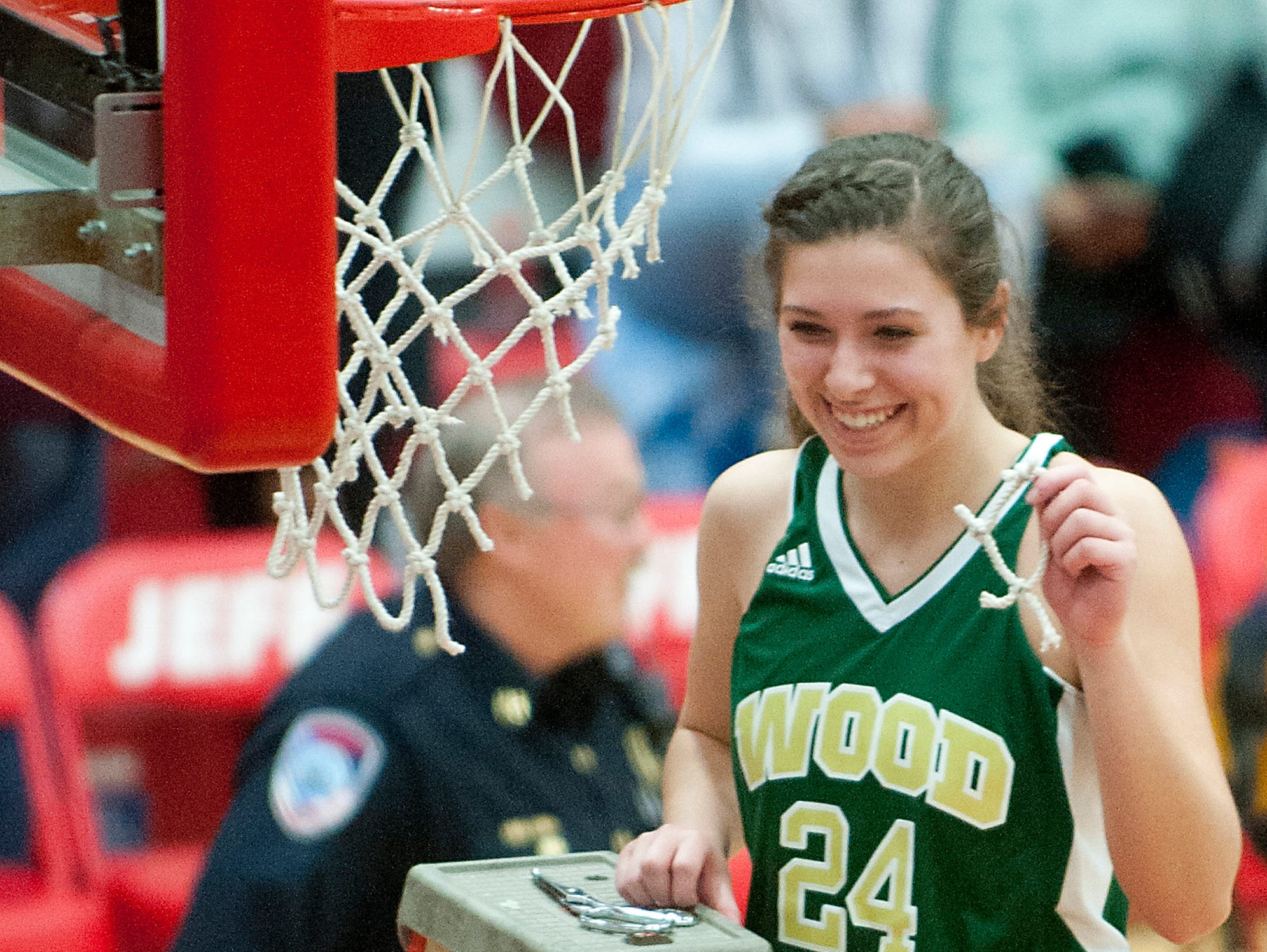 Wood Memorial player Katie Thacker shows off her part of the net she cut down after her team beat Tindley 59-50 in the IHSAA girls' class 1A semi-state. 17 February 2017