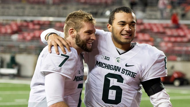 Michigan State quarterbacks Tyler O'Connor (7) and Damion Terry (6) celebrate after defeating Ohio State at Ohio Stadium in 2015.