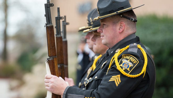 Wicomico County Deputy Sheriff, Sergeant Eric Landing stands alongside fellow deputies during a Veteran's day ceremony at Wicomico Youth and Civic Center on Wednesday, Nov. 11, 2015.