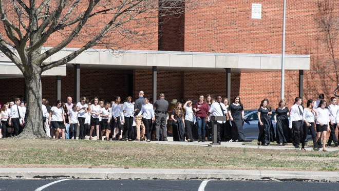 Students leave the school after several children became ill during a choral festival at Wicomico Senior High School on Friday, March 18, 2016.