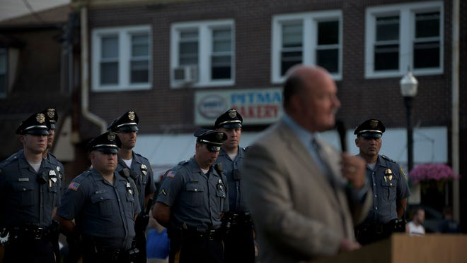 New Jersey Sen. Fred Madden speaks as a police rally is held Thursday evening, July 21 in downtown Pitman.