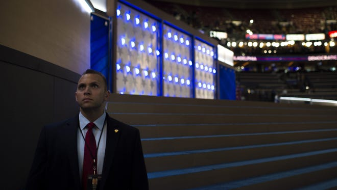 A member of security stands by before the call to order Wednesday at the Democratic National Convention.