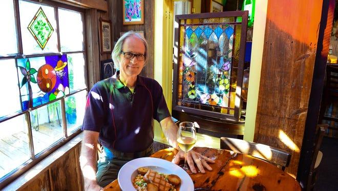Co-Owner Keith Fitzgerald is pictured at The Back Porch CafŽe located in Rehoboth Beach on Monday, Sept. 26, 2016.