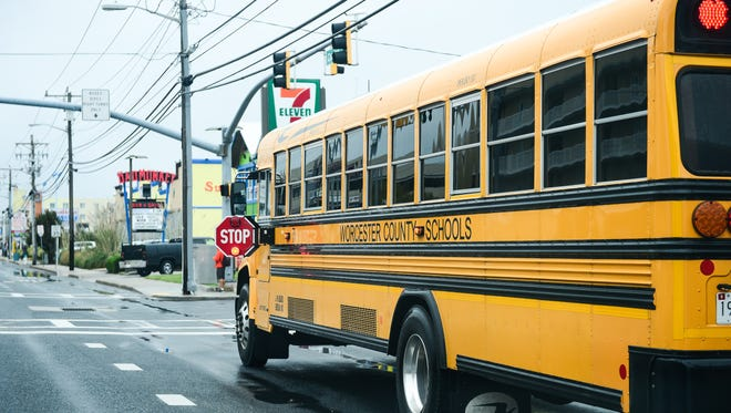 A Worcester county school bus stops along Coastal Highway to let students out on Tuesday, Sept. 27.
