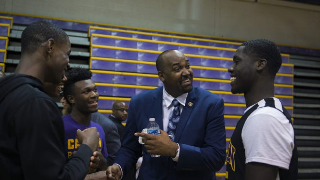 Assemblyman Arthur Barclay greets students Wednesday at Camden High School. Gov. Chris Christie officially announced an estimated $132.6 million project to raze and rebuild the school.