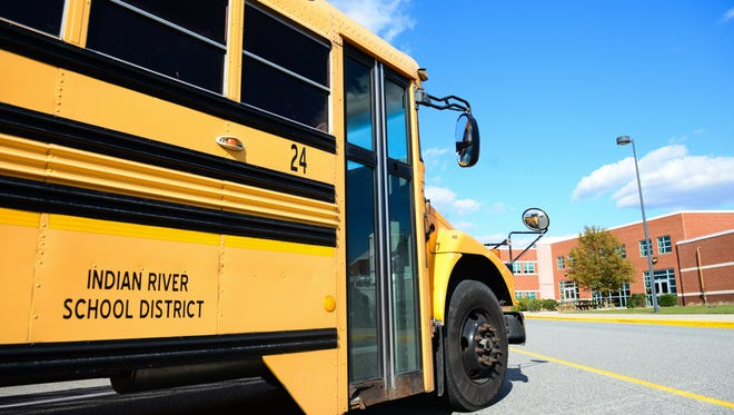 An Indian River School district bus sits outside of Indian River High School on Tuesday, Oct. 26. 2016.