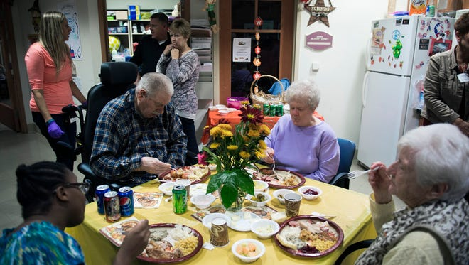 Tenants Russell Munyan, left, and his wife Janet Munyan, with the help of seven of their children, organize a Thanksgiving dinner for fellow tenants Wednesday, Nov. 16 at the Veterans Memorial Home in Vineland.