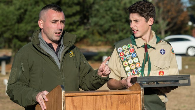 Salisbury Mayor Jake Day speaks to an audience before recognizing the efforts of Boy Scout Ben Smith, 14, at Salisbury Public Cemetery on Wednesday, Nov. 23, 2016.