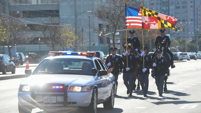 The Ocean City Police Department open the 34th Annual Christmas parade on Saturday, Dec. 3, 2016.