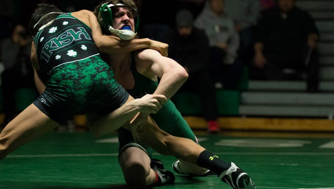 Camden Catholic's Harrison Hinojosa, left, wrestles Seneca's Jack Graff in a 132 pound match Wednesday, Dec. 21 in Cherry Hill.