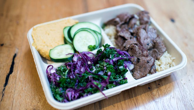 An order of steak, rice, sweet potato hummus and slaw come served on a compostable tray at Real Food Eatery in Philadelphia.