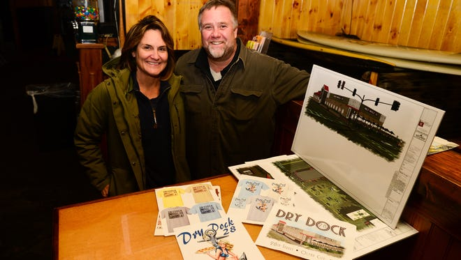 Doug and Annie Buxhaum stand with the renderings and visions of their newest expansion of Dry Dock 28. on Monday, Jan. 30, 2017.