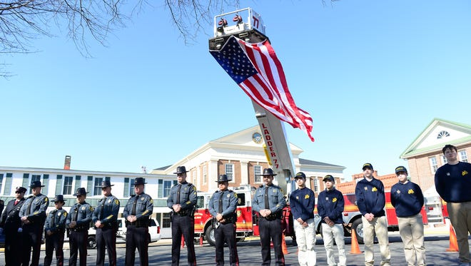 Members of the Georgetown Police Department and Jr. Cadets line The Circle in Honor of fallen Correctional Lt. Steven Floyd Sr. on Sunday, Feb 5, 2017. on The Circle in Georgetown.