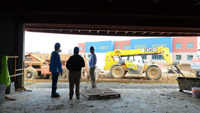 Cape Henlopen's Brian Bassett, (left) Director of Administrative Services talks about the construction of the new multi-purpose cafeteria, auditorium and gym at Love Creek Elementary, Wednesday, Feb. 8, 2017.